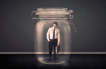 Businessman trapped into a glass jar concept